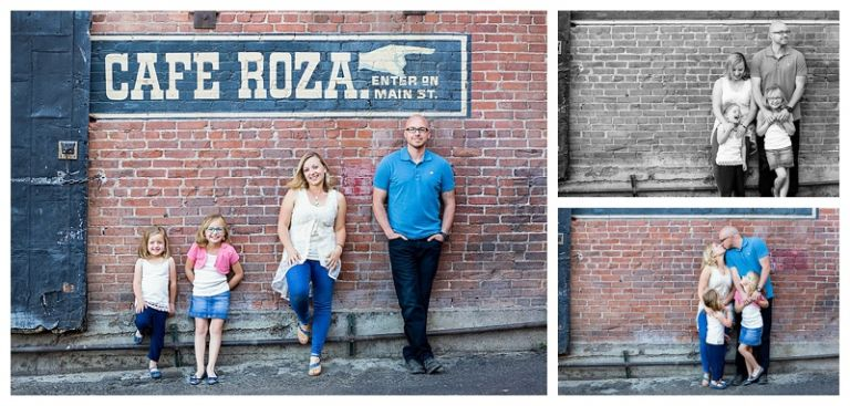 Family posing for photo on brick wall