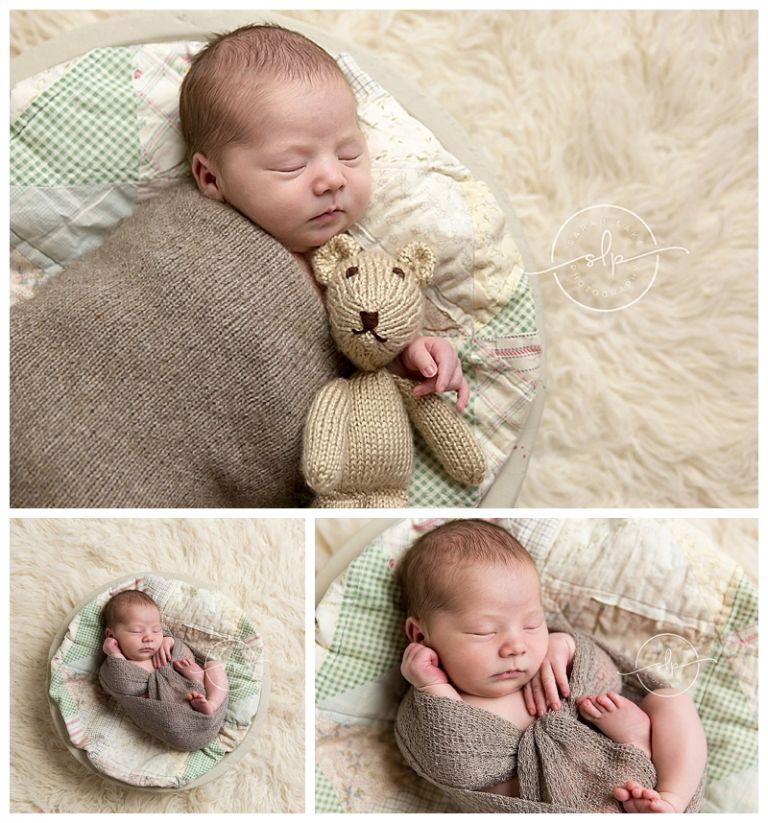 newborn holding teddy bear