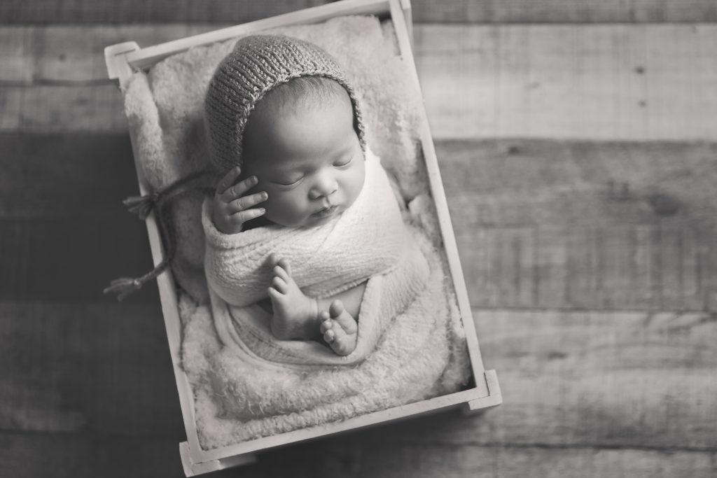 black and white image of sleeping newborn