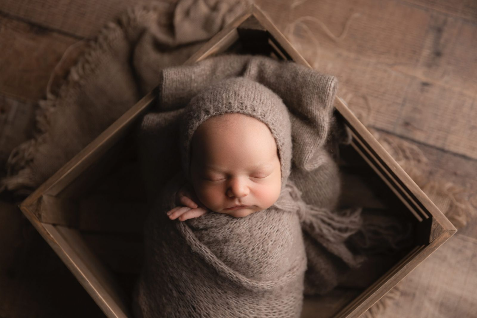 sleeping newborn in neutral colors